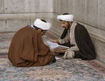 Free Tehran, Iran - 2019-04-16 - Two Holy Men Study At The Holy Shrine Dedicated To Lady Masumeh Fatima Royalty Free Stock Photos - 161372168