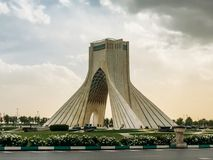 Azadi Tower is the most notable landmark of the city located on the same named square in the middle of scenic park. TEHRAN, IRAN - APRIL 21, 2018: Azadi Tower is stock photography