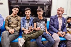 Cheerful Iranian men ride the underground, Tehran, Iran. Stock Photos