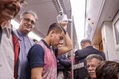 Iranian men of different ages ride the subway, Tehran, Iran. Royalty Free Stock Image