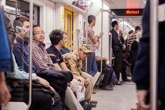 Iranian men go by underground train, Tehran, Iran. Stock Photography