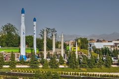 Replica of Iranian military rockets in museum, Tehran, Iran. Tehran, Iran - April 28, 2017: Several long range missiles installed in the Garden of the Holy royalty free stock images