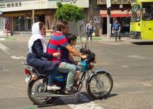 Family motorcycle Tehran road Iran. TEHRAN, IRAN - MAY 19, 2017: Family on a motorcycle on Tehran road. Tehran is the capital of Iran Stock Photography