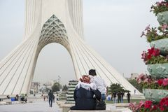 People at Azadi Tower a monument located at Azadi Square and is. TEHRAN, IRAN - 7 May 2018 People at Azadi Tower a monument located at Azadi Square and is a royalty free stock photography