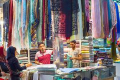 Woman buying shawls, Grand Bazaar royalty free stock photos