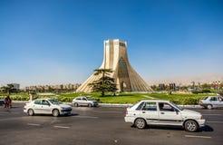 Azadi Tower in Tehran. Tehran, Iran - October 15, 2016: Cars on the stree in front of famous Teheran landmark Azadi Tower on Azadi Square royalty free stock photo