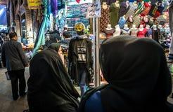 Bazaar in Tehran. Tehran, Iran - October 16, 2016: Iranian woman with black hijabs on the Grand Bazaar in Tehran city Stock Photos