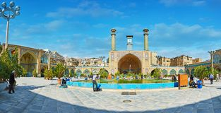 Panorama of Shah`s Mosque courtyard, Tehran. TEHRAN, IRAN - OCTOBER 11, 2017: Panorama of the courtyard of Shah`s Mosque with greenery, fountain, scenic portals Royalty Free Stock Photography