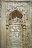 Old mihrab in museum of Islamic Era, Tehran, Iran. TEHRAN, IRAN - OCTOBER 25, 2017: Partly preserved carved mihrab from the medieval mosque in museum of Islamic royalty free stock images