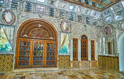 Interior of Golestan Mirror Hall. TEHRAN, IRAN - OCTOBER 11, 2017: The summer terrace of Edifice of Sun Shams-ol-Emareh of Golestan palace is decorated with Royalty Free Stock Photography