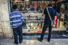 Jeweler shop in Tehran. Tehran, Iran - October 15, 2016: Two man in front of shop window full of signet rings and misbaha praying beads in Tehran Royalty Free Stock Images