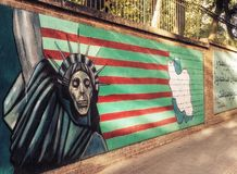 Mural against americans on the walls of the former American Embassy in Teheran royalty free stock photos
