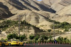 TEHRAN, IRAN- SEPTEMBER 17, 2018: Parking taxi at the foot of the Alborz Mountains in Tehran, Iran royalty free stock photography