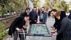 Tehran, Iran - 2019-04-03 - street fair entertainment 16 - foosball 2 - adults long point.  stock footage