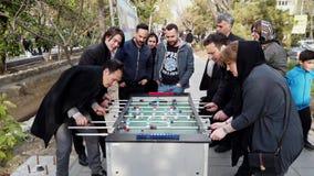 Tehran, Iran - 2019-04-03 - street fair entertainment 15 - foosball 1 - adults.  stock video