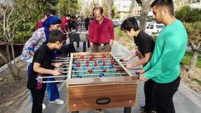 Tehran, Iran - 2019-04-03 - street fair entertainment 17 - foosball 3 - children.  stock video