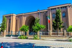 Tehran National Museum of Iran 01. Tehran National Museum of Iran Main Gate Entrance with Waving Iranian Flag on Flagpole stock images