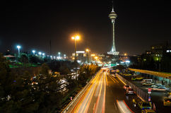Tehran night landscape. Milad tower and cars around Royalty Free Stock Photos