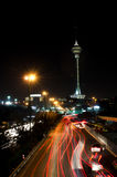 Tehran night landscape. Milad tower and cars around Stock Photos