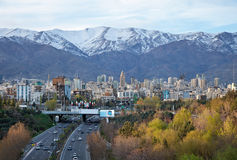 Tehran Skyline and Highway in Front of Snowy Mountains. Tehran skyline and greeneries in front of snow covered Alborz Mountains as viewed from atop of Nature stock image