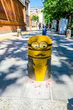 Tehran Traffic Car Blocker. Tehran Artistic Yellow Colored Traffic Car Blocker of an Alien with Eyeglasses royalty free stock photos