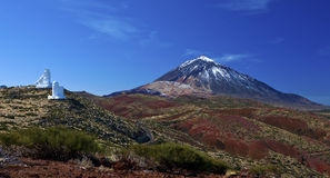 Teide Mountain. A view of mount Teide with a snow cap, on the island of Tenerife with the observation towers stock image