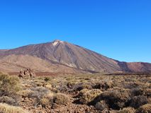 Teide mountain in tenerife with surrounding volcanic landscape Royalty Free Stock Photography