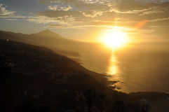 Teide and northern coast of Tenerife, Canary Islands, Spain. Soft, honey-like sunset over the northern coast of Tenerife, with Teide peak in the background and stock photography