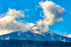 The Teide with snow at sunrise Stock Images