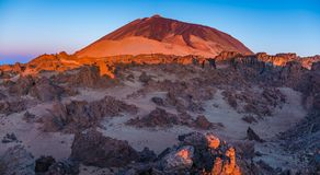 Rocks on the Teide volcano in the light of the rising sun Stock Images