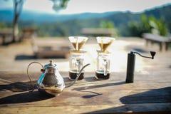 Teiera con la tazza da caffè fotografia stock