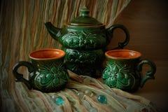 Teiera e due tazze Fotografia Stock