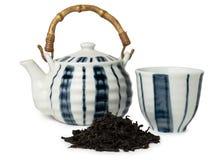 Teiera, tazza e mucchio di tè Fotografie Stock Libere da Diritti