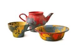 Teiera, tazza e zolla colorate Fotografia Stock