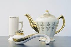 Teiera, tazza ed accenditore Fotografie Stock