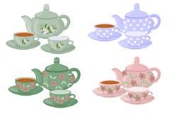 Teiere e tazze con differenti modelli Fotografia Stock