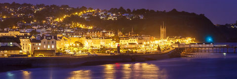 Teignmouth at night Devon England. Dusk overlooking Teignmouth seafront and pier photographed from Shaldon Devon England UK Europe Royalty Free Stock Image