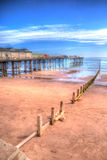 Teignmouth Pier Devon with blue sky and clouds in HDR Stock Image