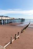 Teignmouth Pier Devon blue sky and sandy beach Stock Photo