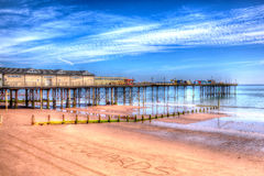 Teignmouth Pier Devon med blå himmel och moln i HDR Royaltyfria Foton
