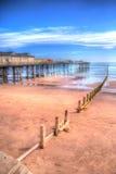 Teignmouth Pier Devon med blå himmel och moln i HDR Fotografering för Bildbyråer