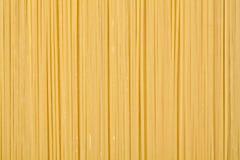 Teigwaren-Hintergrundkonzept Fusilli trockenes Lizenzfreies Stockfoto