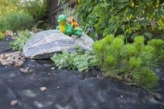 Teil des alpinen Dias im Garten Lizenzfreie Stockfotografie
