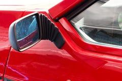 Teil des alten roten Sportautos Stockbild