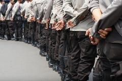 Teil- indonesische Polizei des Körpers von der Rückseite Lizenzfreie Stockfotografie