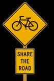 Teilen Sie die Straße mit Fahrrad-Zeichen Stockbild