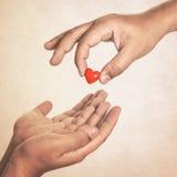 Teilen Sie Ihre Liebe Stockbild