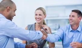 Teilhaber, die Hände rütteln Lizenzfreies Stockbild