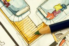 Teilweises Immobilienillustrationsbildmaterial des Wohnzimmergrundrisses mit Sofas, vibrierenden Kissen und Bleistift Stockfoto