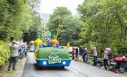 Teisseire Caravan. Le Markstein, France- July 13, 2014:Vehicles advertising Teisseire during the passing of the Publicity Caravan in front of exciting spectators Royalty Free Stock Photos